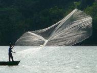 fisherman at Ak'Tenamit
